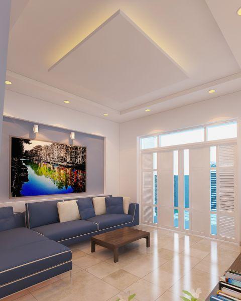 Phòng khách nổi bật với sofa màu xanh dương và tường âm trang trí