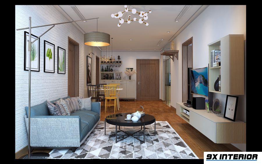 Phòng khách bố trí theo mạch liên thông nhằm tận dụng tối đa ánh sáng từ mặt thoáng