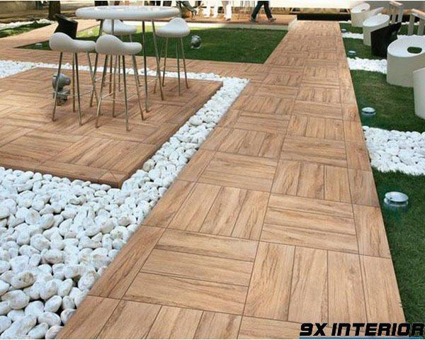Gạch lát sân thượng trang trí kết hợp sỏi, cỏ nhân tạo