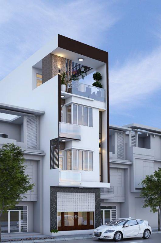 Thiết kế nhà ống 3 tầng 1 tum ấn tượng với phần phối màu sáng tạo. Tone màu nâu tạo điểm nhấn và nổi bật giữa màu trắng chủ đạo, giúp căn nhà thêm sang dù chỉ nhìn từ ngoài vào