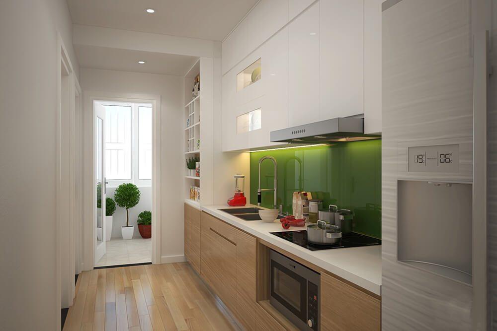 Phòng bếp được bố trí gọn gàng với tủ bếp chữ I màu trắng
