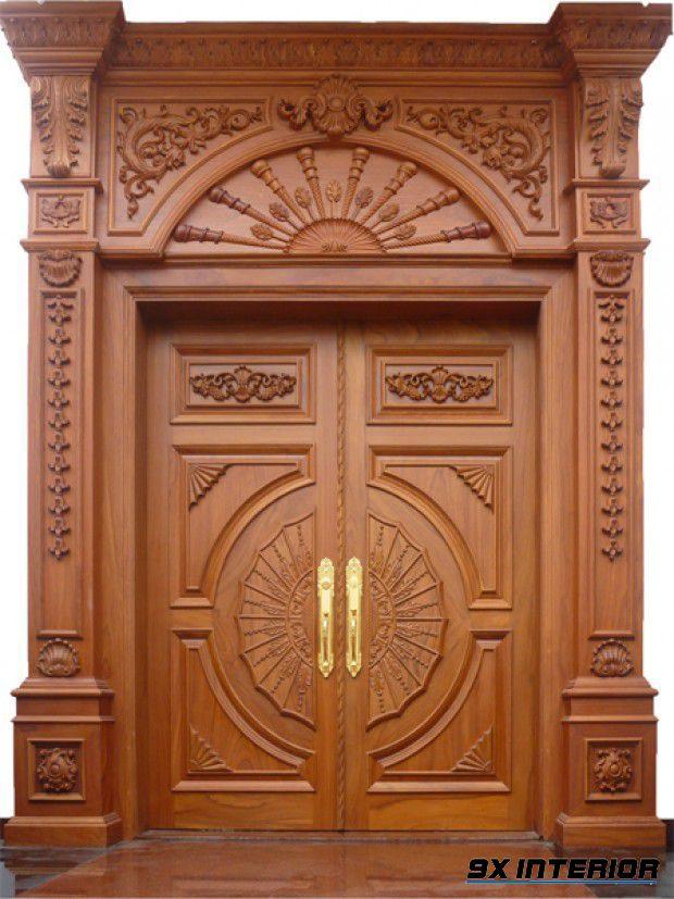 Mẫu cửa chính 2 cánh bằng gỗ gõ đỏ được chạm khắc tinh tế, cầu kì