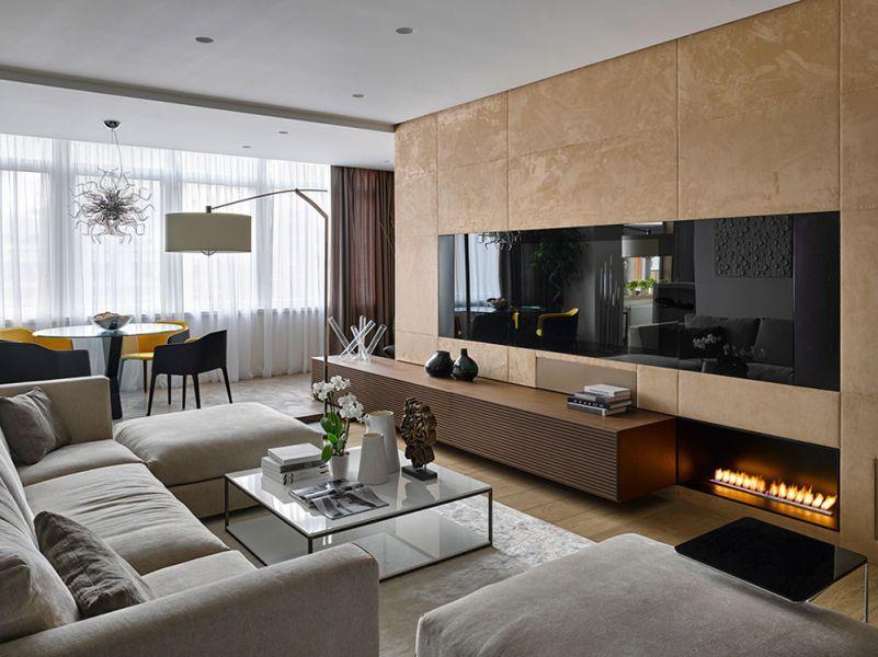 Màu be và ghi xám hài hòa với gỗ tự nhiên ở tường và sàn trong căn phòng đơn giản và ấm cúng.